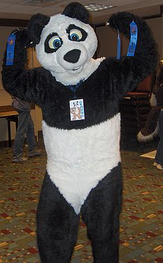 Panda shows off his fursuit games awards at Midwest FurFest 2006's fursuit games